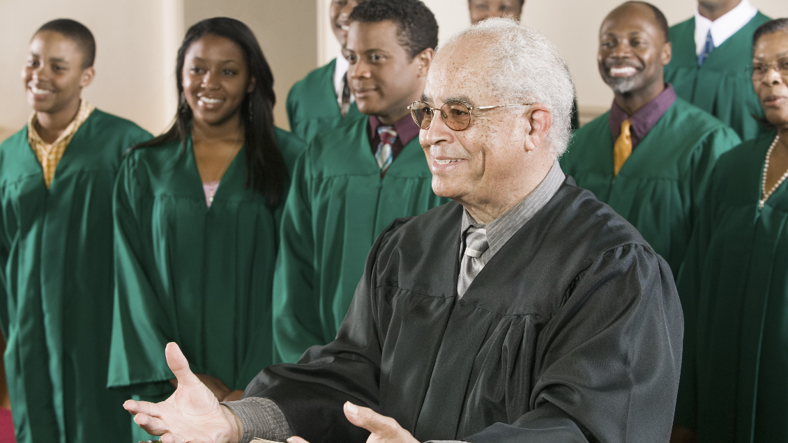 Pastor preaching in front of choir