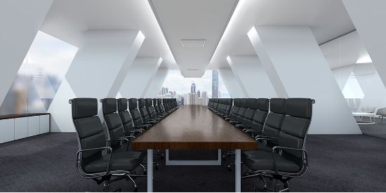 Modern boardroom with long wooden table and black swivel chairs