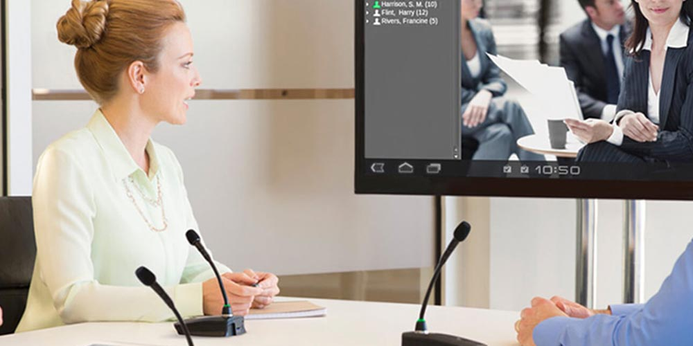 Professional looking at screen during meeting