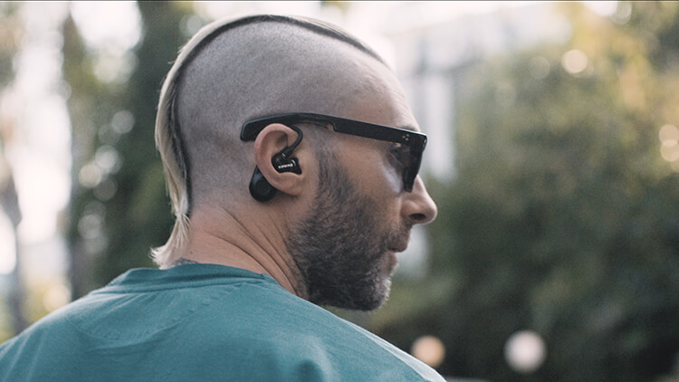 Adam Levine wearing Aonic 215 earphones